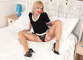 Naughty mature Mouse playing with her toys