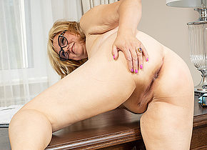 Housewife masturbating on her desk