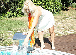 Naughty housewife playing in the garden