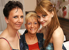 Three old and young lesbians make out