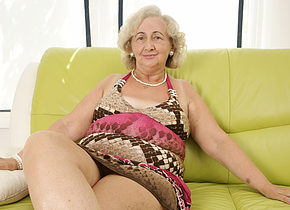 mature grandma playing with a purple dildo