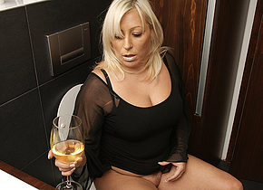 Chubby blonde housewife getting wet