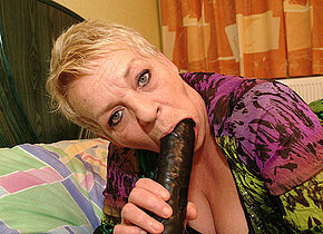 Horny European mama playing with her toy