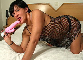 kinky housewife playing with her toy on the bed