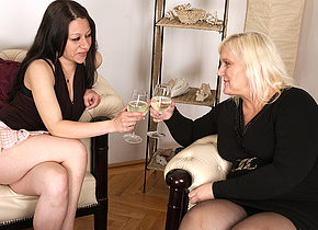 A hot babe doing a mature lesbian on the couch
