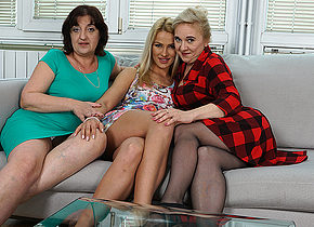 Three old and young lesbians having a ball on the couch
