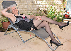 Horny British mature lady getting wet in her garden